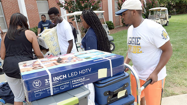 New residents use their dorm checklist for Freshman move-in day at North Carolina A&T State University.