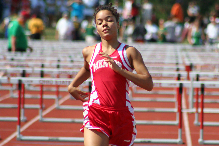 Female student-athlete completes a track meet and hopes to become NCAA eligible for college