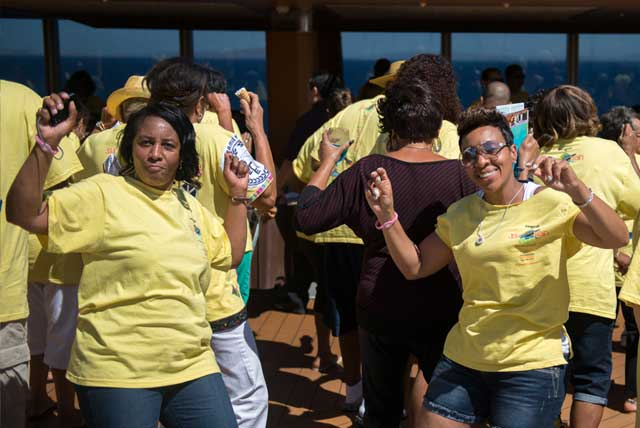 Soul Train Cruise 2014: Two female passengers on deck dancing at the T-Shirt Pool Party.