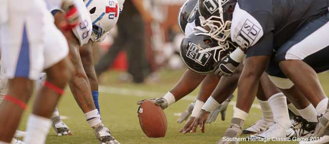 The Tennessee State University Tigers Defense lines up against Jackson State University on the gridiron during the 2011 Southern Heritage Football Classic before the ball is snapped.