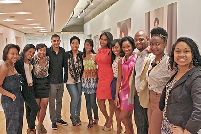 Former Essence Magazine interns pose for group photo in Magazine's office.