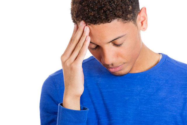 Black male college student stressed over not qualifying for a Parent PLUS Loans.