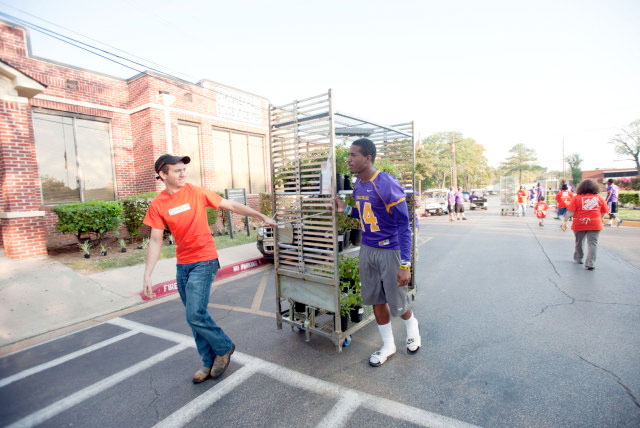 Retool Your School 2014: Home Depot employee assists an HBCU student with moving plants for campus improvements.