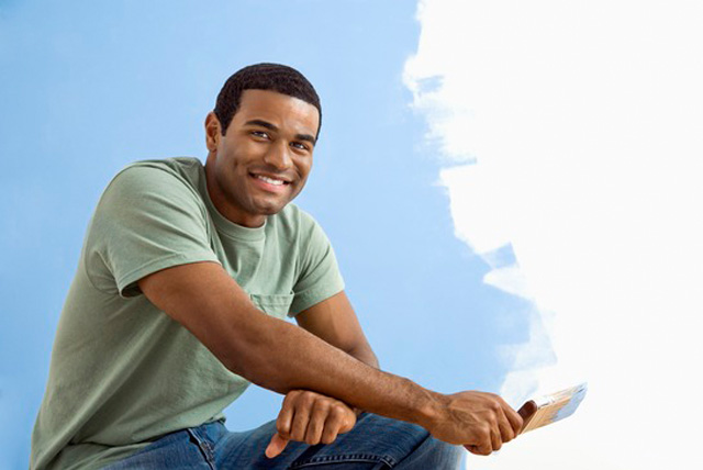 Summer Jobs for College Students: Male HBCU students with paint brush painting rooms during summer break.