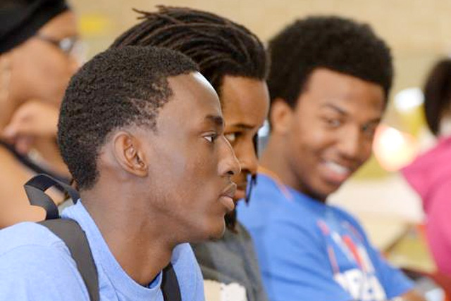 Black Male freshmen students listen to SU System President at Southern University and A&M College orientation.