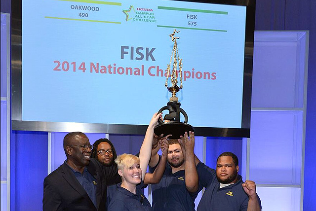 The Fisk University team holds up the 25th Annual Honda Campus All-Star Challenge Trophy.