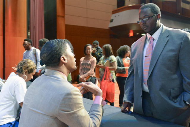 y'Quish Keyes, (right) a Buick Scholarship recipient, gets advice from Fonzworth Bentley, artist and pop culture icon during a celebrity meet and greet for a recent UNCF Empower Me Tour event in Atlanta, Ga.