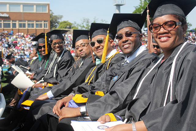 A group of graduates pose at the 2014 Hampton University Commencement ceremony.