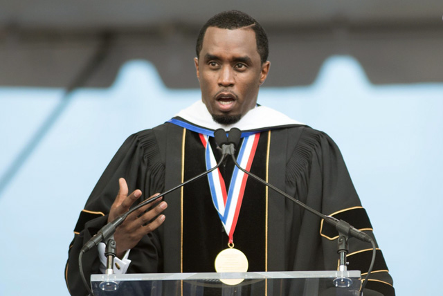 Sean Combs stands at podium delivering his 2014 Howard University commencement speech.