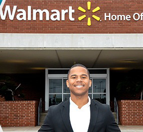 HBCU student stands in front of Walmart Home Office