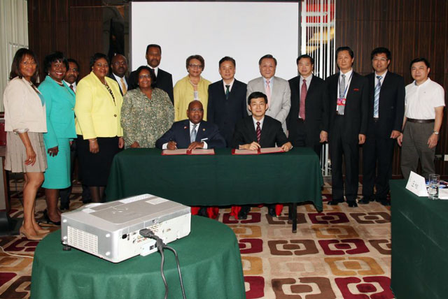 MOU signing between 8 HBCUs and the China Education Association for International Exchange (CEAIE) in Beijing, China on July 9, 2014. Dr. David Wilson (seated on left) signed the MOU on behalf of the delegation of senior administrators from Bowie State University, Hampton University, Howard University, Morehouse College, Morgan State University, Spelman College, Tougaloo College and Xavier University of Louisiana.