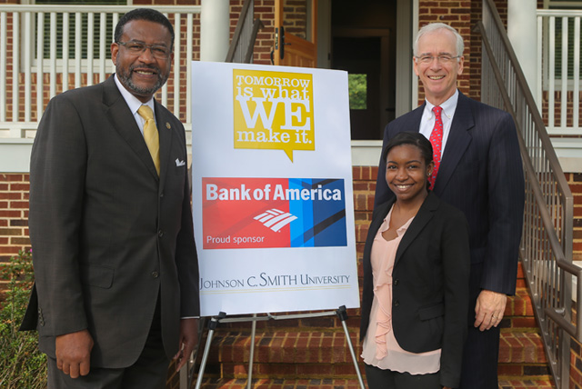 Dr. Ronald L. Carter, president of Johnson C. Smith University poses with a Bank of America grant representatives in front of the Dr. George E. Davis House.