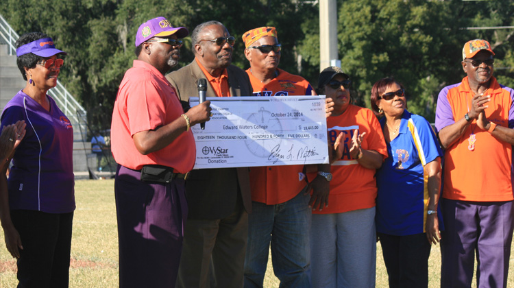 EWC President Nathaniel Glover, members of the EWC Alumni Association and Jacksonville, Florida Alumni Chapter pose with donation check during homecoming.