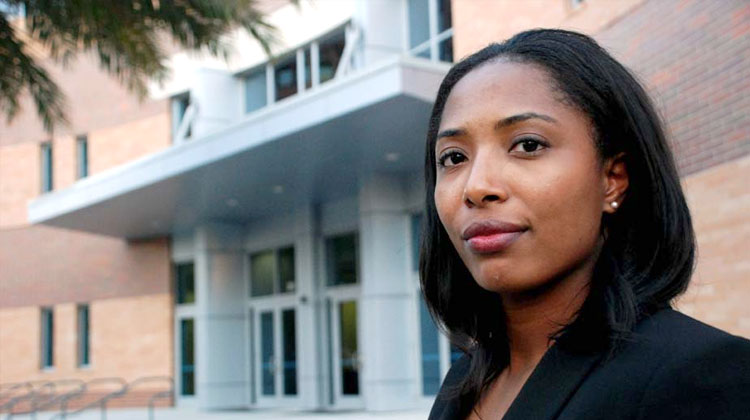 Law student Herrittaccei Shabazz stand in front of the FAMU College of Law building in Orlando, Florida.