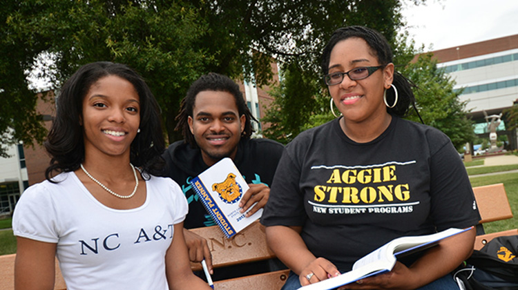 """Three students show their """"Aggie Pride"""" on the campus of North Carolina A&T State University."""