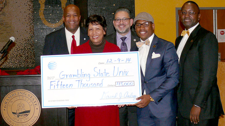 Elected officials Senator Rick Gallot and State Representative Patrick Jefferson pose with Grambling State Interim President Dr. Cynthia Warrick, Ph.D. holding a $15,000 check from AT&T Aspire.