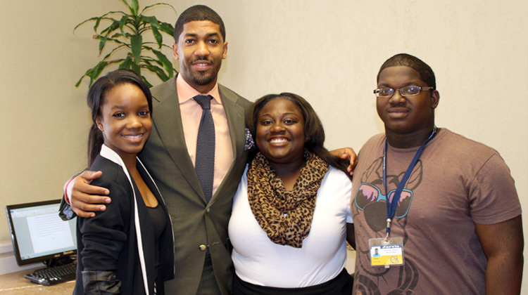"""Derek """"Fonzworth Bentley"""" Watkins poses with future leaders on the campus of Jarvis Christian College."""