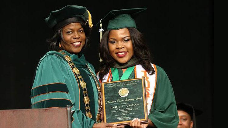 FAMU SGA President and Board of Trustees member Tonnette Graham receives the President's Student Leadership award from Florida A&M President Dr. Elmira Mangum.