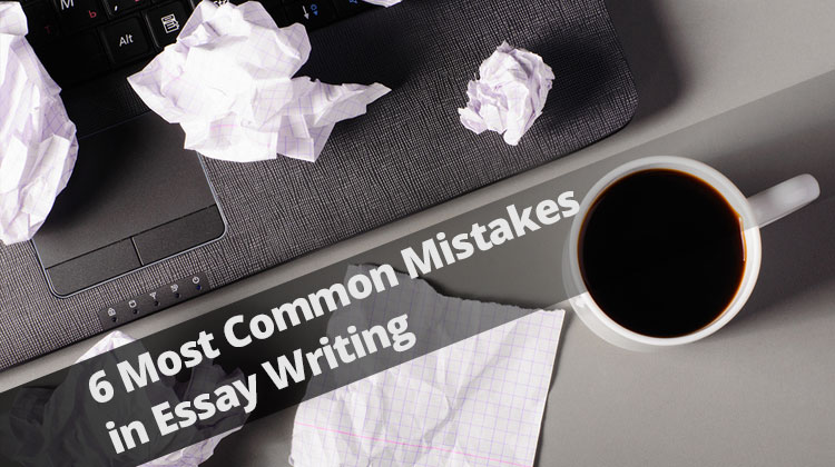 Most Common Mistakes In Essay Writing Laptop Sheets Of Paper And Crumpled Wads On Table