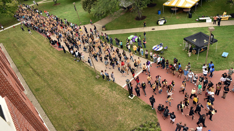 Led by West Virginia State University President Brian O. Hemphill and other members of the administration and faculty, the fall 2015 WVSU freshman class, and transfer students, walk to the plaza of the Wilson University Union as part of the fourth annual State Stride on Tuesday, Aug. 18. Photo courtesy of West Virginia State University