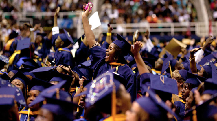 Students react as First Lady Michele Obama delivers the commencement address at the North Carolina Agriculture & Technology commencement ceremony in 2012.