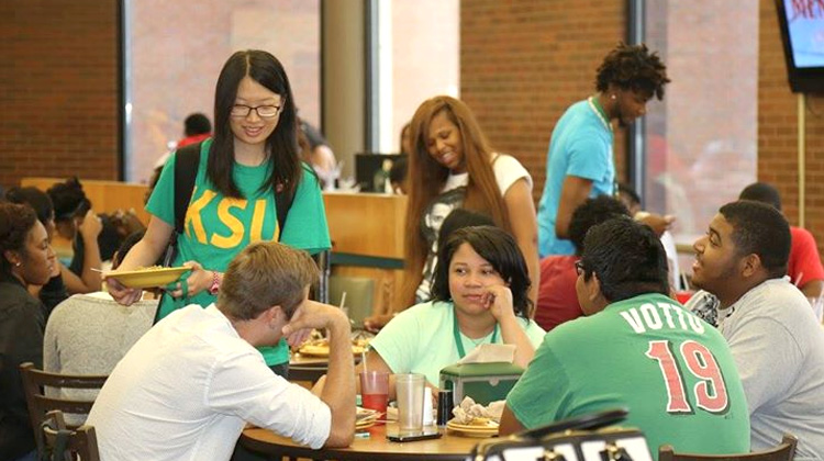 Kentucky State University students enjoy a meal together in the campus cafeteria.