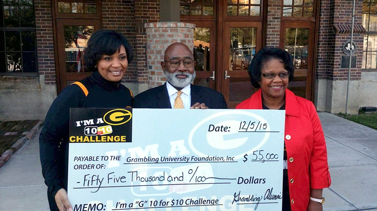 President Willie Larkin accepts a $55,000 check presented by members of the 10 for $10 Challenge Campaign Committee.