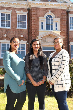 Claflin students, Meha Patel and twins Helen and Myrtle Bryant.