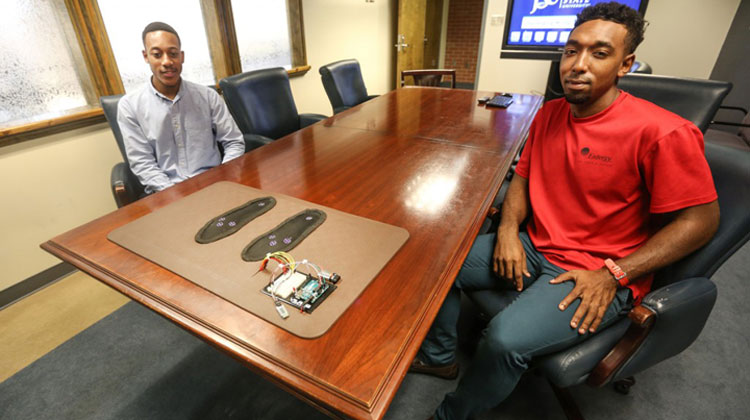 """Chevan Baker, left, a senior computer engineering major from Kansas City, Mo., and Jann Butler, a senior computer engineering major from Pascagoula, Miss., were among four who helped develop a senior design project called the """"smart mat"""" to determine the foot temperature of diabetics. (Photo by Charles A. Smith/JSU)"""