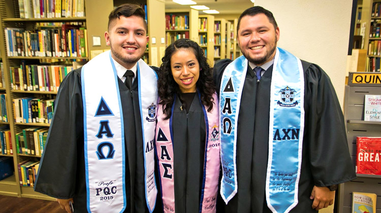 Happy Paul Quinn College class of 2015 Hispanic students pose before commencement ceremony.