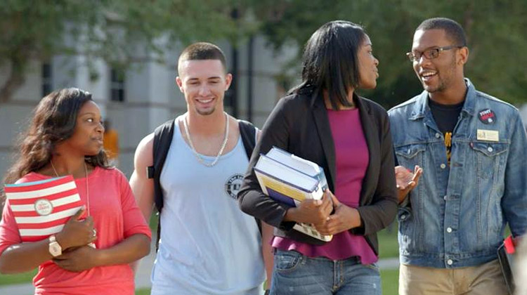 Happy students walking the campus of The University of Arkansas at Pine Bluff as the university see an increase of student applications.