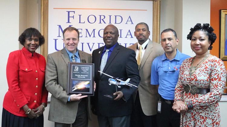 Cessna Pilot Center presents Florida Memorial University with official plaque.