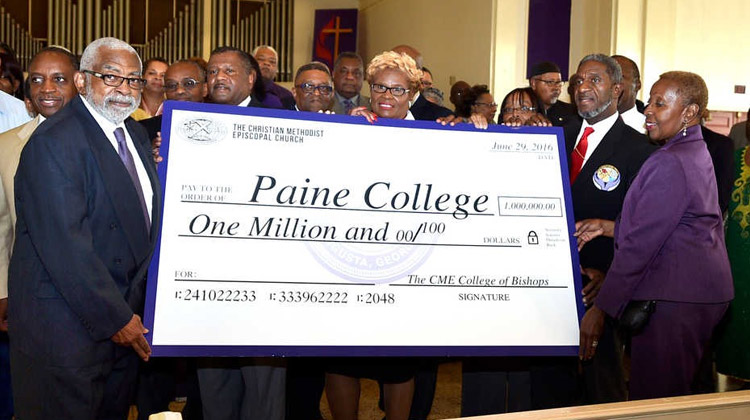 The Christian Methodist Episcopal (CME) Church clergy presents an over-sized check that drew a deafening round of applause from Paine faculty, staff, students, alumni, trustees, and friends.