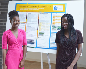 Lincoln University STEM students Deanee Love and Oyinbarakemi Ndiomu present findings from summer research project.