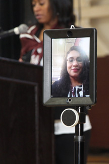 AAMU faculty member Stacy Carter conducts a history class on the Huntsville campus from his suburban Birmingham home in Hoover using telepresence robot.