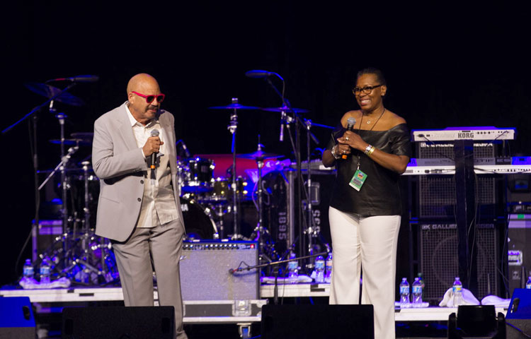 Tom Joyner and Cheryl Harris on stage at the 2016 Allstate Tom Joyner Family Reunion