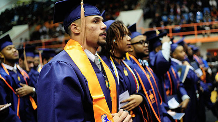 Morgan State University graduates stand proud at commencement ceremony.