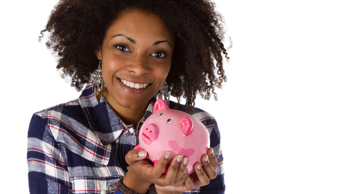 Young african american woman with piggy bank Young african american woman with piggy bank