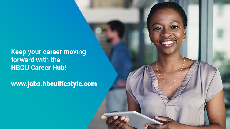 Smiling young HBCU professional woman holding a tablet viewing the HBCU Career Hub.