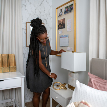 Brittany Goddard checks the décor in her new dream-room space designed by Whitney Jones in partnership with The Home Depot.