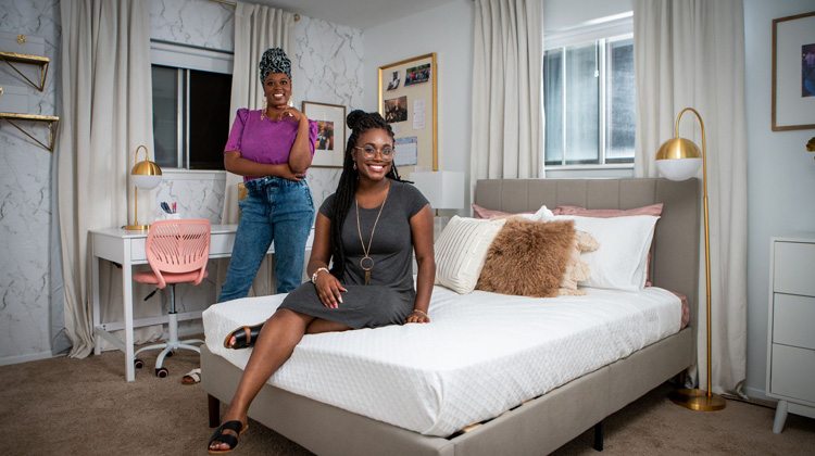 Interior designer Whitney Jones and Howard University graduate Brittany Goddard in her completed dream room makeover furnished by The Home Depot.