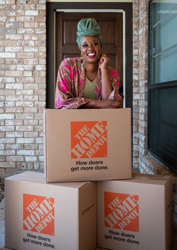 Interior designer Whitney Jones stands with boxes from The Home Deport prior to Brittany Goddard's doorstep before a dream room makeover.