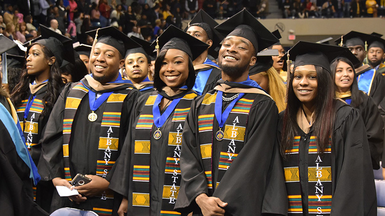 Proud Albany State University graduates celebrate at a 2019 Commencement Ceremony.